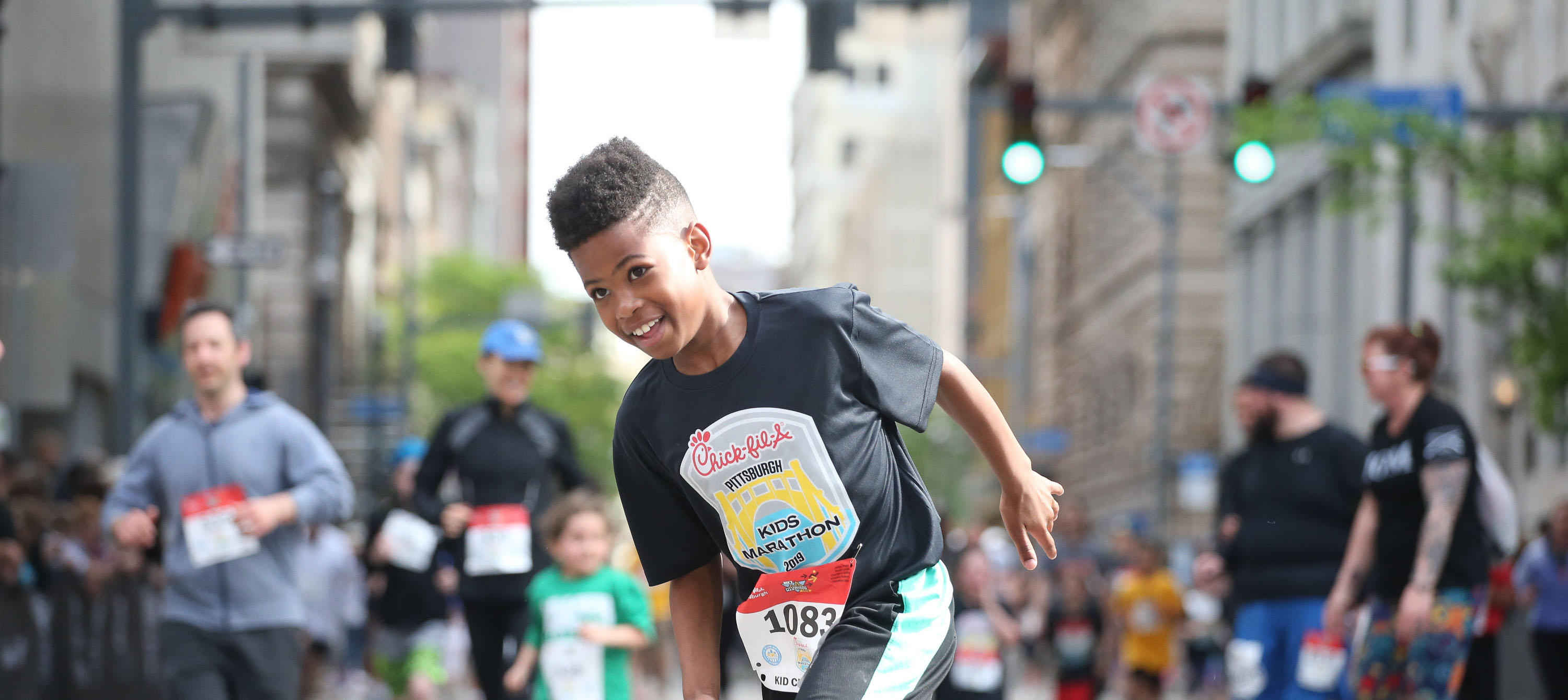 young boy running in the Kids Marathon
