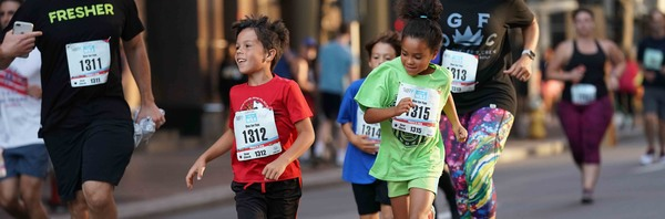 Two kids running in the Fleet Feet Liberty Mile