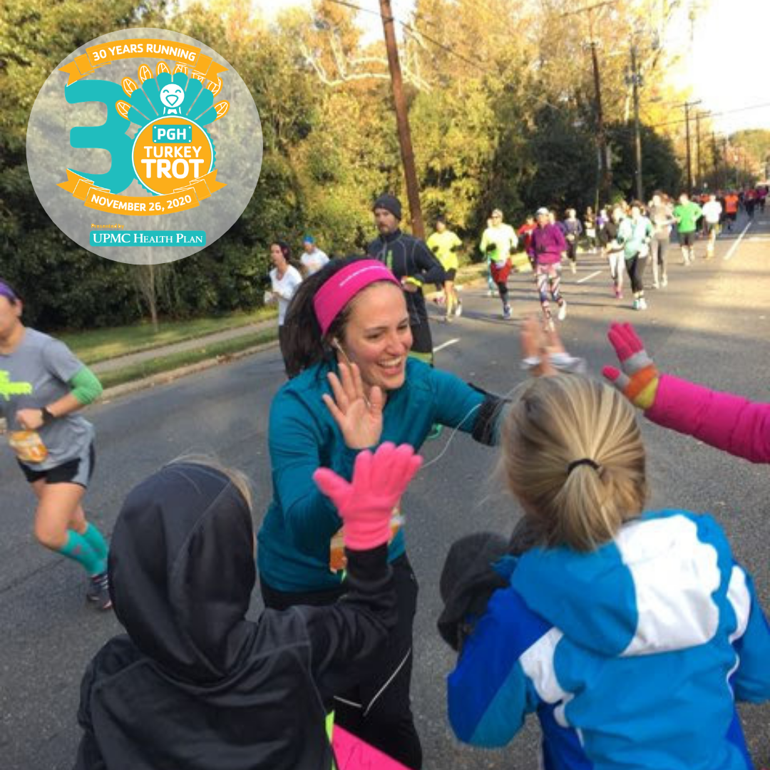 P3Runner Katie Kinnamon high-fives her family on the race course